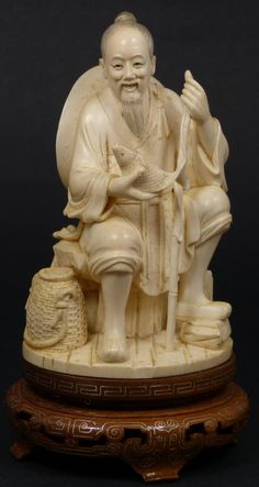 Antique Chinese hand carved ivory figure of fisherman