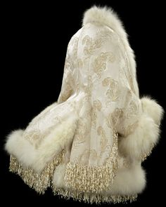 """1885 French Jacket at the Victoria and Albert Museum, London - From the curators' comments: """"This dolman-sleeved jacket was considered the epitome of luxury and good taste in the late nineteenth century. It would have been thought highly fashionable in combining fur as a trimming and a feather design in the fabric, elements from the natural world that fascinated society at the time."""""""