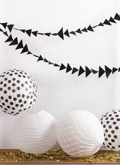 Unique black triangle confetti garland to spice up any party | 10 Monochrome Party Ideas - Tinyme Blog