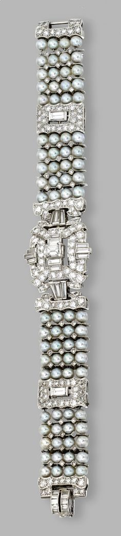 PLATINUM, PEARL AND DIAMOND BRACELET, CIRCA 1930. Set with old European-cut, single-cut and baguette diamonds weighing a total of approximately 10.00 carats, and pearls measuring approximately 4.4 mm., length 7 inches.