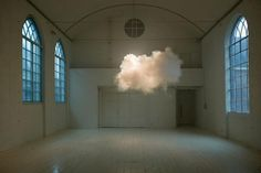 Actual clouds (no photoshop) created by a Dutch artist inside his empty gallery.