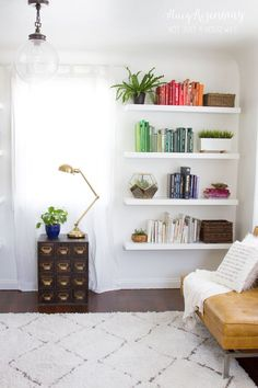 family room book shelves styled by color