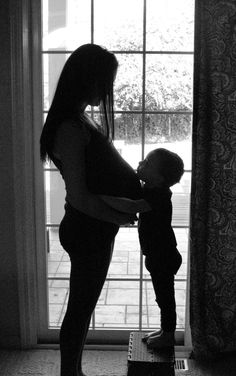Maternity photo with older sibling. I'm in love with silhouettes during maternity shoots