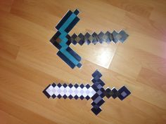 I printed out pix axes and diamond swords and pasted them on foam boards also a party favour for the boys #minecraft