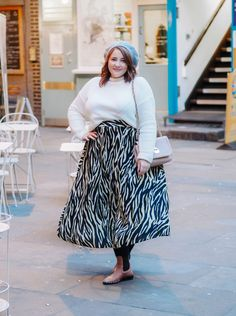 A bargain animal print midi skirt: add a splash of the exotic to your wardrobe Style your zebra print with monochrome basics for a wearable outfit. Winter outfit inspiration, plus size fashion inspiration. Repin and click to read my tips on how to style the animal print trend.  #hayleyhall