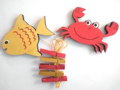 Playroom - Children's  Artwork display hanger- Red crab and yellow fish -sea friends decor -kids wall art, kids art hangers, children wall decor. $18.00, via Etsy.