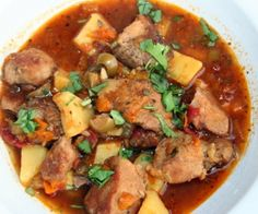 Paleo Puerto Rican Pork and Potato Stew.  Tender pork simmered with briny olives and salty capers. This stew brings the flavors of Puerto Rico straight to your kitchen! #paleo #glutenfree