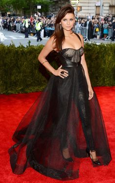 The Vampire Diaries star went full vamp punk at the 2013 Met Gala, wearing a Monique Lhuillier corseted, black lace pantsuit complete with a black leather halter and tulle overskirt. Oh, and lest we forget her major Rupert Sanderson black patent leather pumps. To sum up this look: sick getup, sick smoky eye, sick side sweep. Love.