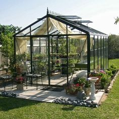 "Janssens Royal Victorian L x W x H Greenhouse at Lowe's. The Victorian Greenhouse is one of the premier greenhouses in the ""Helios"" line of greenhouses from Janssens of Belgium. Diy Greenhouse Plans, Best Greenhouse, Backyard Greenhouse, Greenhouse Wedding, Greenhouse Panels, Homemade Greenhouse, Pallet Greenhouse, Aquaponics Greenhouse, Portable Greenhouse"
