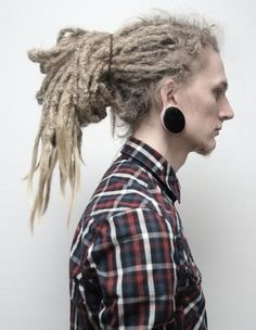 Dreadlocks and gauges...this guy is beautiful. Don't think I could talk Justin…