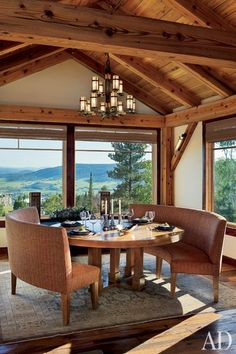 South Park co-creator Trey Parker crafted a hilltop haven for his family in Steamboat Springs, Colorado. With designer Michael Rath's help, Parker was able to meld a Japanese aesthetic with the alpine vernacular of the house, whose dining area offers expansive views of the lush landscape. (May 2010)
