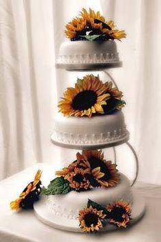 Three white satellite wedding cakes decorated with yellow sunflowers