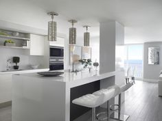 This stunning white contemporary kitchen was completed by Sheryl Bleustein Interiors. #luxeFL