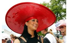 Miss America, Laura Kaeppeler, enters the Downs after making an appearance on the red carpet at the 138th running of the Kentucky Derby at Churchill Downs in Louisville, Kentucky, Saturday, May 5, 2012.