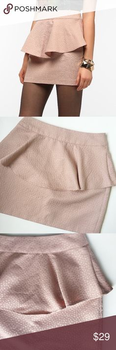 Silence + Noise Jacquard Peplum Mini Skirt • Urban Outfitters 'Silence + Noise' • Jacquard Texture • Peplum Mini Skirt • Gold Zip Up in back • No stretch  Size: 2 Color: Light Baby Pink / Mauve Rose Condition: Excellent Used Condition Material: 54% Polyester 46% Cotton *Stock photo shown for fit and style*  Measurements Length: 26 inches Waist: 28 inches All measurements are approximate.  No stains, rips, tears | Pet/Smoke free home. Offers welcomed ✨ Urban Outfitters Skirts Mini