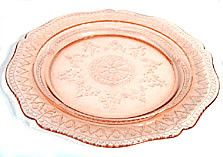 Here is a pink Depression Glass plate in the Patrician or Spoke pattern. It was made by Federal and it measures 11 inches wide. This plate is all in good condition with no chips, cracks or scratches.