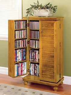 Compact cabinet stores over 600 CDs! This attractive Mission-style cabinet fits in a small space, yet offers storage for 612 CDs, 298 DVDs or 172 VHS tapes! Made of solid oak, it fits in a space less than wide and blends with most decors. Dvd Storage Units, Ikea Dvd Storage, Dvd Storage Cabinet, Storage Ideas, Movie Storage, Storage Solutions, Storage Rack, Storage Shelves, Organizar Dvds