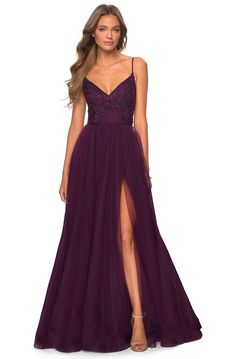 Elegant floor length prom gown with full tulle skirt and striped rhinestone bodice. Features a faux wrap V-neck top with thin spaghetti straps and a full V-shaped back. Dark Purple Bridesmaid Dresses, Dark Purple Dresses, Pretty Prom Dresses, Tulle Prom Dress, Grad Dresses, Ball Dresses, Eggplant Bridesmaid Dresses, Plum Bridesmaid Dresses, Tulle Tutu