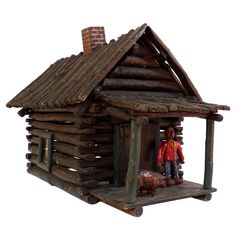 American Folk Art Cabin- id put it under the christmas tree tucked so the low braches almost cover it. As if the little guy lives in the woods