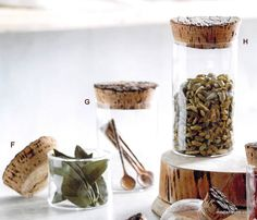 Show off the beauty of spices and other kitchen staples with this modern crafted collection. Handmade glass vessels i slightly imperfect, organic cylinders and sphere shapes are topped with natural cork stoppers. Corks are cut directly from oak cork bark with the rough top bark layer left intact. The glass cylinders and sheres are made from sturdy borosilicate glass to hold up well in a busy kitchen.