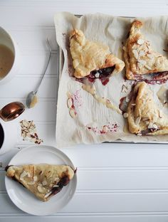 Blueberry Turnovers. Puff pastry which is one of my loves. Blueberry jam adds to the magic of these scrumptious gems.