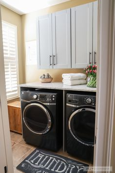 Beautiful laundry room makeover with The Home Depot - your one-stop shop for all things cleaning! Store-bought cabinets and counters make this laundry room much more stylish and functional.