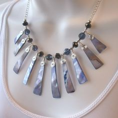 Blue Shell Bib Necklace - Wire Wrapped - Graduated Paddle Shells - Blue and Brown Polished Glass Beads. $37.50, via Etsy.