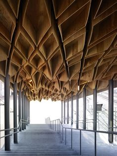 Wooden canopy of this station in Japan symbolizes the pulling together of the fragmented community.