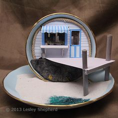 Beach Shop and Pier Scene in a teacup by Lesley Shepherd i think this would also work with cheese/hat box