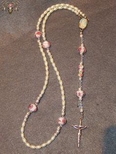 Pearl and Rose Glass Bead Rosary Visit www.twistedthingamajigs.com to place your order and see more of our merchandise.