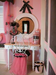 Poodles, Paris and a Pink Bedroom. Black feather boa glued around mirror reflected in mirror.