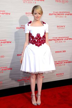 In a Chanel dress and Christian Louboutin heels at the Los Angeles premiere of The Amazing Spider-Man.   - ELLE.com