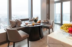 Powell and Bonnell Design Inc.  Such an inviting breakfast nook. Positioned to take advantage of the breathtaking view. Perfect furniture for this space.