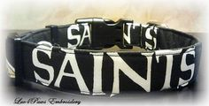 New Orleans Saints Adjustable Collar in black, white and gold Saints cotton fabric, made with heavy weight interfacing and a durable curved nylon acetate buckle. A small collar charm is included.  **Legal Disclaimer: My Sports themed collars are NOT Officially Licensed products of the NFL, NCAA, or related teams and are not affiliated with Luv4paws in anyway. I make my collars with official, team licensed fabric and designs that I purchased. by Luv4PawsEmbroidery