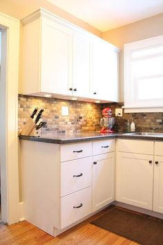 Love the cabinets! Small Kitchen Remodel with Slate Tile Backsplash | featured at Remodelaholic.com #smallkitchen #remodel #backsplash @Remodelaholic .com .com .com .com