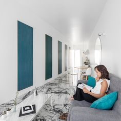 using a gently curved wall as the main design feature, the studio has carefully re-organized and clarified the interior spaces.