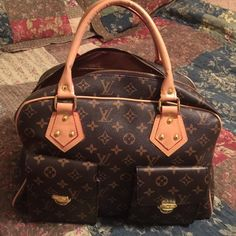 Hand Bag NOT A REAL Louis Vuitton! Purse size medium to large. Beautiful bag with two pouch pockets inside. Outside has two pockets with clips. New excellent condition. Only used twice. Too big for me. Like New❤️ Bags Satchels