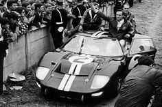 The Ford GT40 Mark II of Bruce McLaren (in the car) and Chris Amon (out the door) at the 24 Hours of Le Mans in 1966