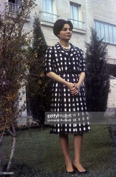 Empress of Iran Farah Pahlavi (Farah Diba) posing in the garden of Echtesassi Palace. Farah Pahlavi is the third wife of the Shah of Iran Mohammad Reza Pahlavi from which she is expecting a child. Tehran, May 1960.