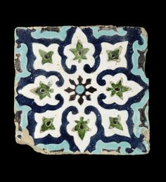 A Timurid cuerda seca pottery Tile   Uzbekistan, late 14th/ early 15th Century  of square form, decorated in cobalt blue, turquoise, green, white and black with an eight-petalled rosette, each petal containing a palmette   35 x 33.5cm