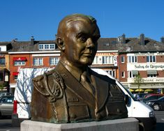 """Place McAuliffe near the center of Bastogne, called after General Tony McAuliffe, the 101st's Artillery commander and acting Commander of the Division. The 101st wasn't going to deploy to Bastogne, The 82nd got on the road before the 101st did, and they were sent north. The 101st went on to Bastogne with General McAuliffe in command. When the Germans demanded surrender, he sent back his famous reply """"NUTS."""" This is probably the most famous quote of World War II. Photo credit Dalton in Flickr Most Famous Quotes, North Africa, World War Ii, Division, Photo Credit, Acting, Battle, Two By Two, American"""