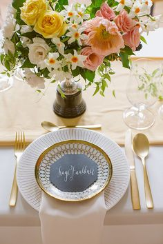 Modern gold place setting with a geometric place card | Photo by Rebecca Wood | Styling by Laura Olsen | Floral design by Sweet Woodruff