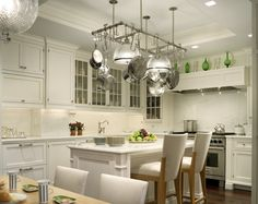 White kitchen with hanging light fixture designed by John B. Murray Architect