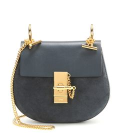 Chloé - Drew Mini leather and suede shoulder bag - Investing in a Chloé bag is a smart choice, and the 'Drew' silhouette is the ultimate in uncomplicated chic. This cool blue leather piece is finished on a glossy note with a twinkling gold-toned shoulder chain. A true staple accessory to favour for seasons to come. seen @ www.mytheresa.com