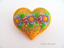 yellow heart with blue flowers pin