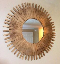 You can use popsicle sticks to create a beautiful frame for a mirror.