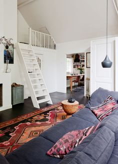 Dark couches, colorful rug and neutrals