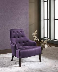 Part of me loves it because it is purple.  The other part thinks it would be a comfortable chair.