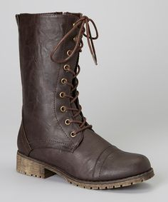 Casual has never looked so good, and these low-heel boots constantly deliver! The timeless, simple combat design combines effortlessly with a bronze studded lace-up look that is never short on comfort.1.25'' heel9.5'' shaft12.5'' circumferenceLace-upMan-madeImported