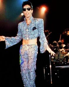 Besides the long hair....I liked the this style clothing....it was his most unique...besides the outfit with his face one.... Who else can pull this off....the one and only Prince!!!!